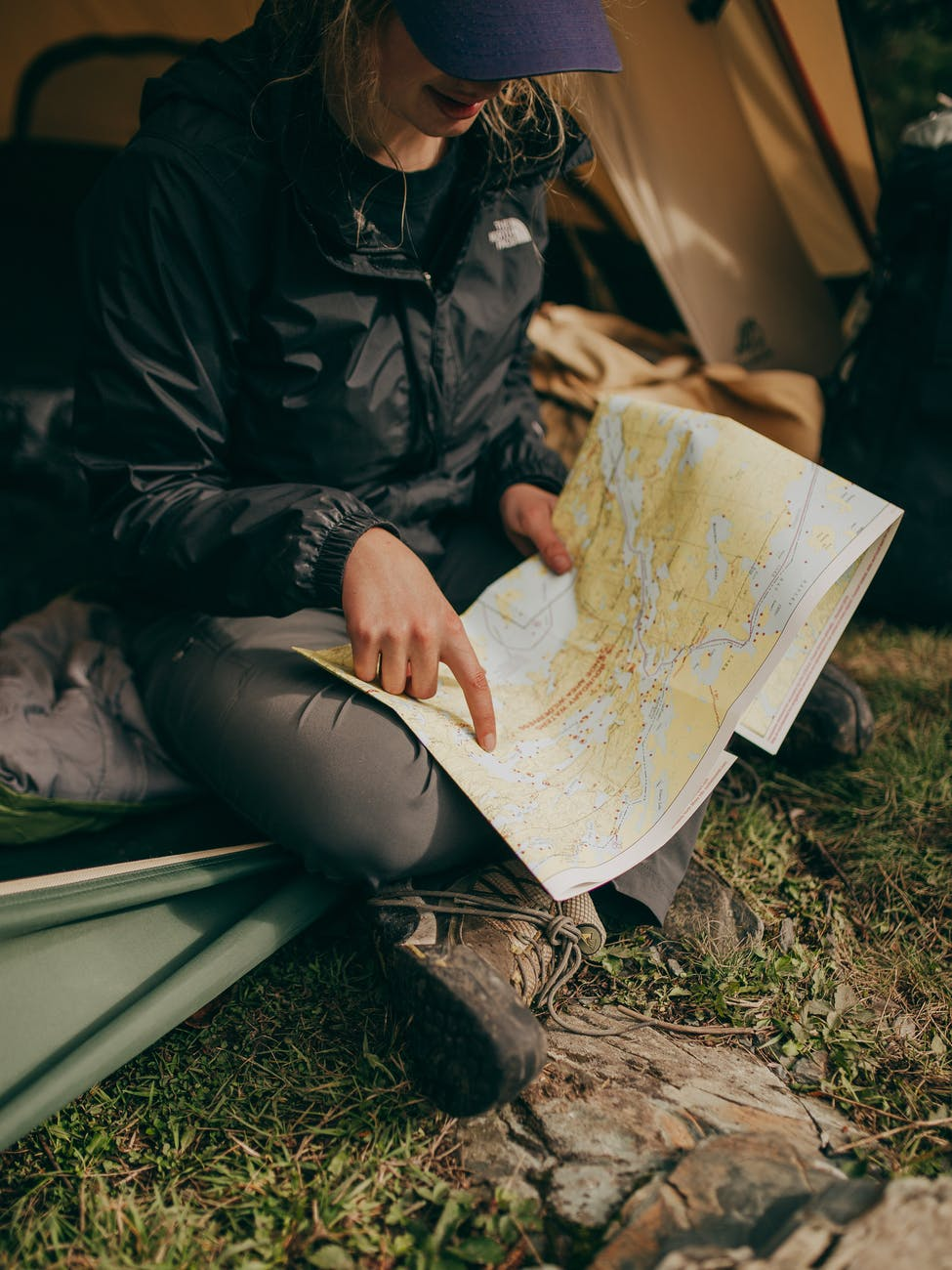 Camper looking at paper map planning next day's journey
